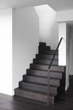City Penthouse designed by Hare + Klein featuring our Raba flooring on these elegant stairs - Tongue n Groove Flooring - Dark Timber Flooring, Timber Stair, Grey Wood Floors, Modern Flooring, Oak Flooring, Black Stairs, Modern Stairs, Interior Stairs, Brick And Stone
