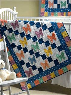 "Butterflies Are Free Crib Quilt. ""Or"" use the four patch and use an applique for the second block. Very cute..."