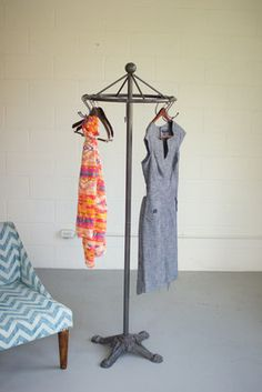 """perfection • Industrial material meets antique design with this raw metal clothes rack• 20½""""d x 68½""""t"""