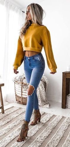 fall outfit idea : crop sweatshirt + rips + boots