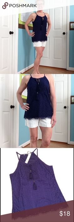 """🆕 Solitaire lacey overlay fringed top Navy blue camisole and lacey overlay shell. Tasseled ties, fringed hem and crocheted across chest. 26"""" length, 19"""" pit to pit. Shell is 65/35 cotton/nylon blend. Lining is 100% polyester. Solitaire Tops Tank Tops"""