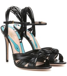 Gucci - Leather sandals - Gucci's delicate sandals are the ultimate elegant finish to your look. The strappy design is crafted from smooth black leather and is finished with a knotted detail to the open-toe front. A tall stiletto heel keeps the look achingly alluring. - @ www.mytheresa.com
