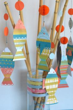 http://www2.fiskars.com/Kids-Activities-School/Projects/Cards/Holiday/Fishy-Fathers-Day#.Uswm5fRDuTM