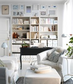bookshelf and pictures...desk in front of shelves and in middle of room.  On window side two chairs facing each other.