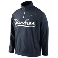 New York Yankees Hot Corner Jacket 1.4 by Nike.  This is a 1/4 zip pullover wind jacket.  Perfect for those cool early mornings.  Has a pouch pocket with zipper, a bungee drawcord at the hem, a tagless collar, and screen print team wordmark on front.  100% polyester.