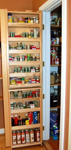 a spice rack on the inside of the pantry door keeps kitchen spices organized and handy