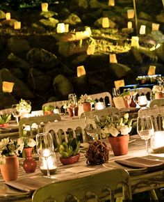 Outdoor vintage romantic wedding.Vintage furniture and lots of candles. By Marweddings