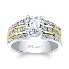 Romance is in the air with this classic three row diamond engagement ring featuring a prong set round center diamond. The white gold shank sports three rows of diamonds cascading down the shoulders. The center row is channel set in yellow gold  and flanked by a white gold row of shared prong set diamonds on each side for an updated traditional look.<br /> <br /> Also available in two tone rose gold, 18k and Platinum.<br />