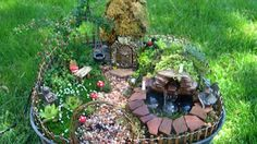Fairy garden with pond and waterfall miniature. This is awesome! A must do project.