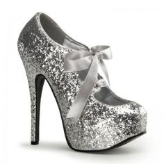 Teeze Silver Glittered Platform Pump - New at ShoeOodles.com Price: $75.00  Glitter covered pump has a concealed platform that is about 3/4 inches high and a 5 3/4 inch heel. Satin bow tie front for a touch of whimsey. In so many pretty colors it will be hard to choose just one - here in wear with everything metallic silver! The perfect party shoe!  All man made materials with padded insole and non-skid sole.  #gothic #fashion #steampunk