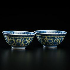 Pair of Rare Qianlong Blue and Yellow BowlsChinese, Qing dynasty, Qianlong period. Two rare blue and yellow footed bowls decorated with chrysanthemum motifs on the exterior. Qianong mark to underside; ht. 2.25 in.; dia. 5 in.