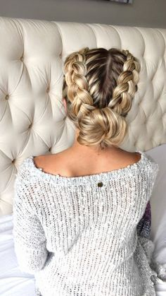french braids into a bun with blonde highlights