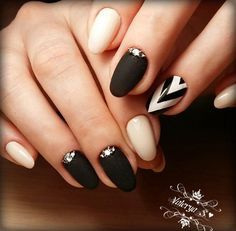 Black and White Chevron Nail Art. This royal looking black and white chevron nails have got my mind. The sparkle and the simplicity are simply captivating.
