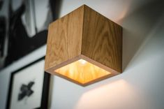 Wooden wall lamp with simple functional design. This cube has two options: switch is located aside, or with wire. We only use recycling wood, no trees were harmed during the making of this product :) Made of wood pieces with accent on natural wood texture Edison Lampe, Led Lampe, Plug In Wall Sconce, Wall Sconces, Wooden Decor, Wooden Walls, Bedside Lamps Wood, Diy Luminaire, Wood Sconce