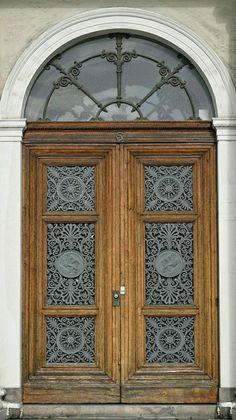 Lovely detail on this wood door in Gothenburg, Sweden. - photo by Ingunn Eriksen