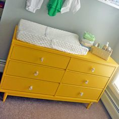 I can't decide between this yellow color or a green for my wardrobe.  I am loving this changing table with the cute numbers though!