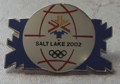 OLYMPIC GAMES PIN alt Lake 2002 Olympics Blue Snowflakes Globe Silvertone Badge