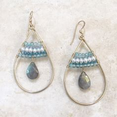 Labradorite, freshwater pearl, chalcedony adorn these hand forged hoops of 14k goldfill by Noelani Hawaii  Handmade in Haleiwa, HI