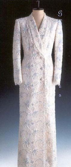 Diana wore this Catherine Walker coat-dress on November 9, 1988 on an official visit to Chambord, France. The Princess of Wales attended a dinner function at Du Chateau De Chambord in Paris. Diana wore it again on June 7, 1989 for the Royal Opera House performance of Trovatore. The dress is made of white Reichers lace and is adorned with blue and white sequins. This gown is lot #53 and it raised $ 27,600 for Diana's charities.