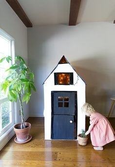 Make a fun DIY playhouse from a cardboard box! With only a few hours and imagination you can make something special your new home
