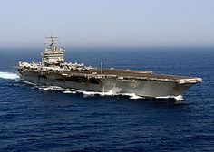 """USS Enterprise (CVN-65), formerly CVA(N)-65, is the world's first nuclear-powered aircraft carrier and the eighth United States naval vessel to bear the name. Like her predecessor of World War II fame, she is nicknamed the """"Big E"""". At 1,123 ft (342 m),[3][4] she is the longest naval vessel in the world. Her 93,284 long tons (94,781 t)[2] displacement ranks her as the 11th-heaviest supercarrier, after the 10 carriers of the Nimitz class. Enterprise has a crew of some 4,600 people."""