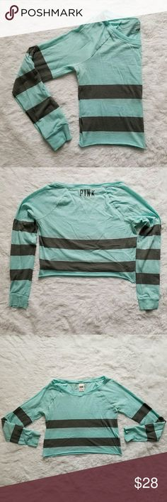 """{VS PINK} Cropped Long-Sleeve Tee Fun Tiffany blue and charcoal grey striped rugby tee. Long sleeves. Size medium. Raw bottom hem. 19"""" best laying flat across. Has been washed often, and has some slight pilling around the cuffs, etc. Still in good condition. No flaws or stains.   Everyday ocean turquoise t-shirt; so cute with skinny gray sweatpants.  I offer 20% bundle discounts. Cheers!  *No modeling or trades* PINK Victoria's Secret Tops Tees - Long Sleeve"""