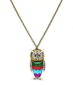 """Gold-burnish necklace with green, turquoise, and purple textured body. Accented with silver-burnish face and wings. 2.5"""" pendant/30"""" necklace"""