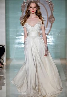 Satin chiffon gown with gathered waist and embroidered bodice and sleeve detail