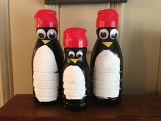 Our cute winter penguins made from recycled coffee creamer bottles. Painted with acrylic paint, glued on wiggly eyes and yellow tape for the mouths.