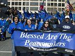 'Blue Lives Matter:' Demonstrators march to the US capitol in 'Sea of Blue' rally to support police  http://www.dailymail.co.uk/news/article-2914934/Blue-Lives-Matter-Demonstrators-march-capitol-Sea-Blue-rally-support-police.html