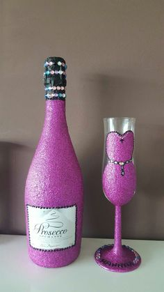 Pink glitter prosecco bottle and glass