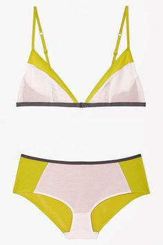 The Sweet SpotBubble-gum pink and mustardy yellow may not sound super appetizing. But the colorblock effect (anchored by a dark-gray trim on both the bralette and the brief) is the right kind of weird. #refinery29 http://www.refinery29.com/non-lace-lingerie#slide-16