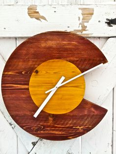 Hey, I found this really awesome Etsy listing at http://www.etsy.com/listing/130179458/colorado-wall-clock-by-coloradojoes