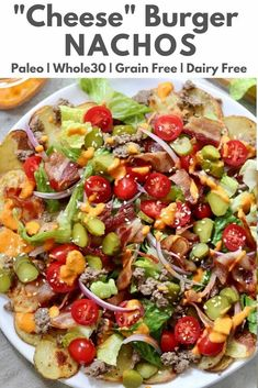 "Mix up your mealtime routine with these Grain Free, Whole30 and Paleo Bacon ""Cheese"" Burger Nachos. Roasted potato rounds are topped with ground beef, bacons, tomatoes, pickles, letter, and a cheesey red pepper sauce. #cookathomemom #paleo #nachos"