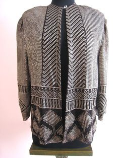 Stunning! 1920s Art Deco Egyptian Revival Assuit Jacket.      I'm quite positive that this was constructed from a piano shawl!  You can see all the hallmark design features of a piano shawl in the patterns of the assiut.
