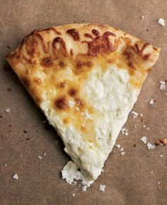 White Pizza Recipe (This white pizza recipe, or pizza bianca, is simply pizza crust smothered in mozzarella and ricotta. No tomato sauce. Pure and simple.)