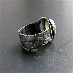Strukova Elena - copyrights jewelry - ring with chrysolite