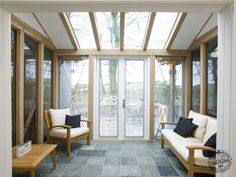 The Counting House Oak Framed and Glazed Conservatory Extension with Glazed Roof by Carpenter Oak