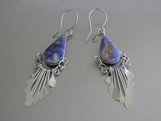 Chandelier earrings featuring a unique blue sodalite stone in every piece, and a very detailed alpaca silver metal wire earring design  These