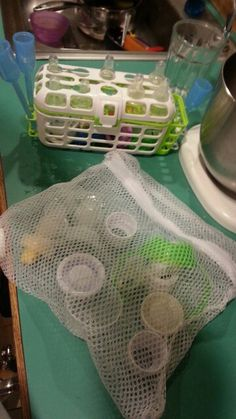 Fabric mesh bags w/zipper are great to sanitize and wash  plastic and rubber bottle parts in dish washer!!! Just thought of this and it works great.by cjd! Also can be used to wash small cloths like socks in washing machine. Great for bath and all other toys. These bags come in packs of three from the dollar store