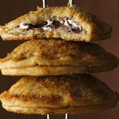 Mini S'mores Hand Pies 1 box Pillsbury® refrigerated pie crusts, softened as directed on box ½ cup graham cracker crumbs (8 graham cracker squares, finely crushed) ¼ cup sugar 3 tablespoons butter, melted Filling ½ cup marshmallow creme 2 tablespoons cream cheese, softened (1 oz) 2 tablespoons sugar ½ cup chocolate chips