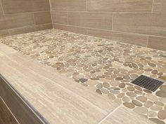 master bath pale pebble tile shower floor natural neutral shower wall tile either stone or wood look in similar lowcontrast color
