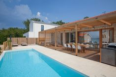 Design Villa, seaview and pool, Silo: Holiday villa for rent from per night. View 22 photos, book online with traveller protection with the owner. Tourist Agency, Heated Pool, Luxury Holidays, Vacation Villas, Luxury Villa, Exterior Design, Croatia, Ideal Home, Swimming Pools