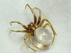 Yellow Gold Moonstone Spider Brooch £1180 Circa 1910-15. There was a fashion for bugs around 1915. Woman wore them on their mainly shoulders.