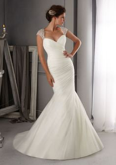 Classy Net Bridal Dress offers so much. The draped Dress has elaborately beaded Crystal Straps and a Stunning back.Colors available: White/Silver, Ivory/Silver.