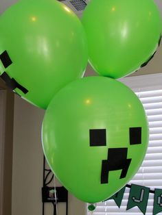 black vinyl shapes (or maybe even construction paper) on green balloons - CREEPER BALLOONS!  Do they hiss then explode?