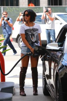 Negative side of being famous, paparazzi all over her while getting gas. smh