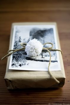 brown wrapping paper + black/white photography + brown yarn + little white pom pom