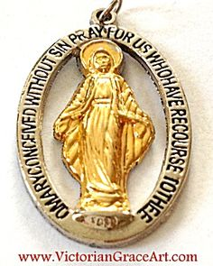 $35 Vintage 2 tone pendant featuring the Blessed Mother, Virgin Mary, as Our Lady of Grace of the Miraculous Medal.  Mary is gold plated, and su...