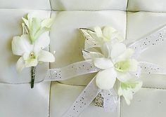 You can't go wrong with white dendrobium orchids with silver and white ribbon, silver-plated leaves attached to a rhinestone bracelet. Just the touch of metallics gives it a uniqueness you can't explain.